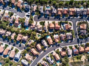 Top down aerial shot of suburban tract housing near Santa Clarita, California. A maze of roads and dead end streets of large single family homes, some with swimming pool.